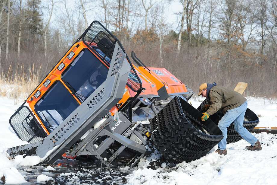 Ice breaker:Gary Cook was driving this 2013 Tucker Sno-Cat Trail Groomer when he accidentally groomed frozen Clark Lake in Nisswa, Minn. He was hoping to round up some heavy equipment to lift the machine out of the water before the ice refreezes. Photo: Steve Kohls, Associated Press