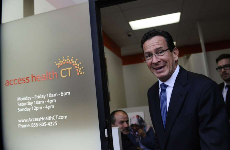 Connecticut Gov. Dannel P. Malloy leaves a grand opening for Connecticut's health insurance exchange's first insurance store, Access Health CT, Thursday, Nov. 7, 2013, in New Britain, Conn.  The site, where people can visit to sign up for coverage, is the first in the nation. Photo: AP Photo/Jessica Hill