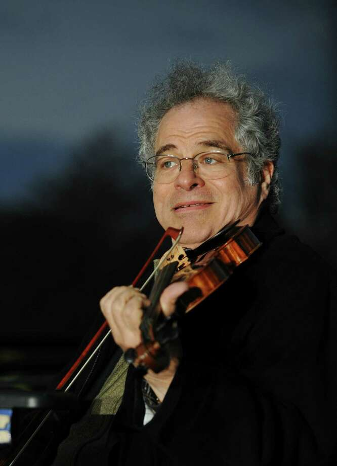 Violinist Itzhak Perlman performs during the annual national Chanukah menorah lighting ceremony on the White House Ellipse December 01, 2010 in Washington, DC. AFP PHOTO/Mandel NGAN (Photo credit should read MANDEL NGAN/AFP/Getty Images) Photo: MANDEL NGAN / AFP