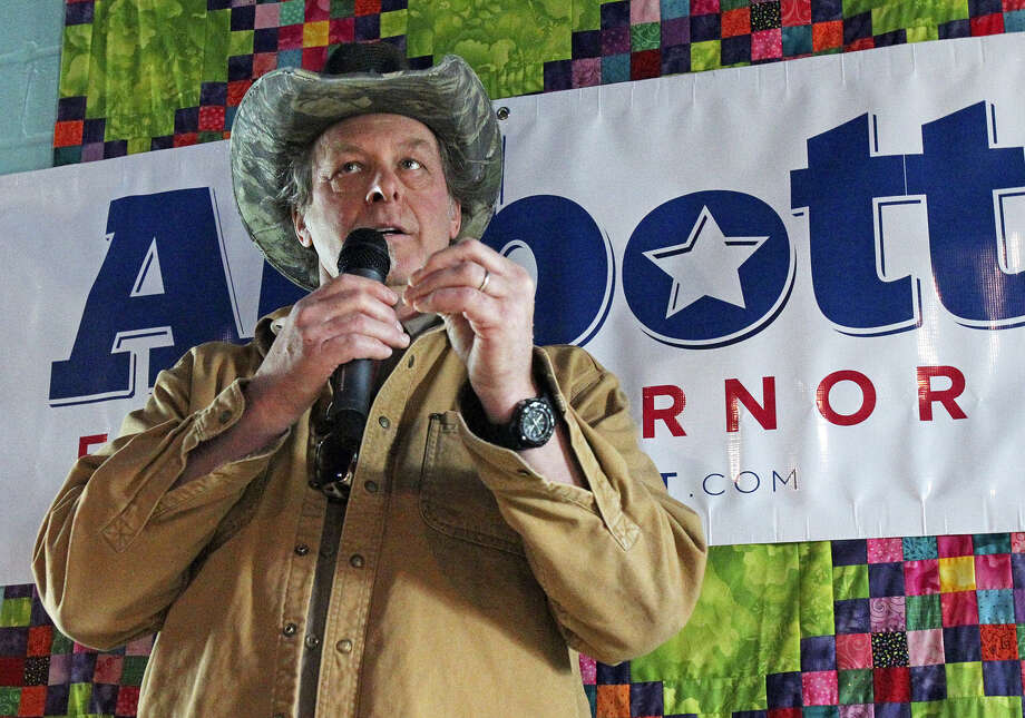 Ted Nugent campaigns for gubernatorial hopeful Greg Abbott. The good for Abbott: He's locked up the gun vote. The bad for Abbott: How many groups did Nugent and the politician alienate? Photo: Tom Reel / San Antonio Express-News