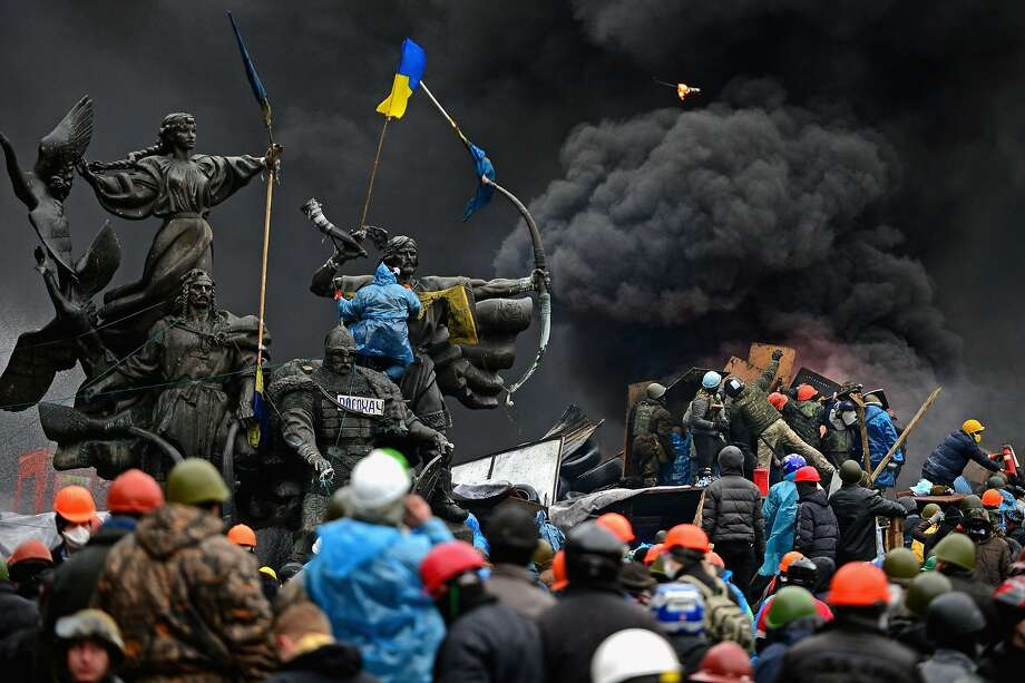 *** BESTPIX *** KIEV, UKRAINE - FEBRUARY 20:  Anti-government protesters continue to clash with police in Independence square, despite a truce agreed between the Ukrainian president and opposition leaders on February 20, 2014 in Kiev, Ukraine. After several weeks of calm, violence has again flared between police and anti-government protesters, who are calling for the ouster of President Viktor Yanukovych over corruption and an abandoned trade agreement with the European Union.  (Photo by Jeff J Mitchell/Getty Images) Photo: Jeff J Mitchell, Getty Images