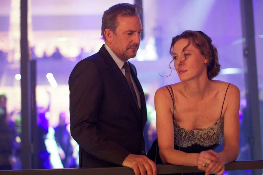 "This image released by Relativity Media shows Kevin Costner, left, and Connie Nielsen in a scene from ""3 Days to Kill."" (AP Photo/Relativity Media, Julian Torres) ORG XMIT: NYET289 Photo: Julian Torres / Relativity Media"