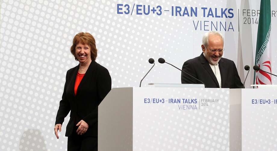 European Union High Representative Catherine Ashton and Iranian Foreign Minister Mohammad Javad Zarif, right, speak to the press after closed-door nuclear talks in Vienna, Austria, Thursday, Feb. 20, 2014. Iran and six world powers are back at the negotiating table eager to come to terms on a comprehensive nuclear deal but deeply divided on what it should look like. The two sides began meeting Tuesday in attempts to build on a first-step accord that temporarily curbs Tehran's nuclear activities in exchange for some sanctions relief. (AP Photo/Ronald Zak) Photo: Ronald Zak, Associated Press