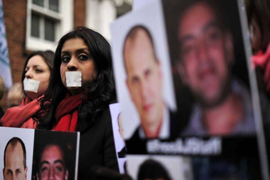 Demonstrators protest outside the Egyptian embassy in London on February 19, 2014 to demand the immediate release of detained journalists in Egypt. AFP PHOTO / CARL COURTCARL COURT/AFP/Getty Images Photo: Carl Court, AFP/Getty Images