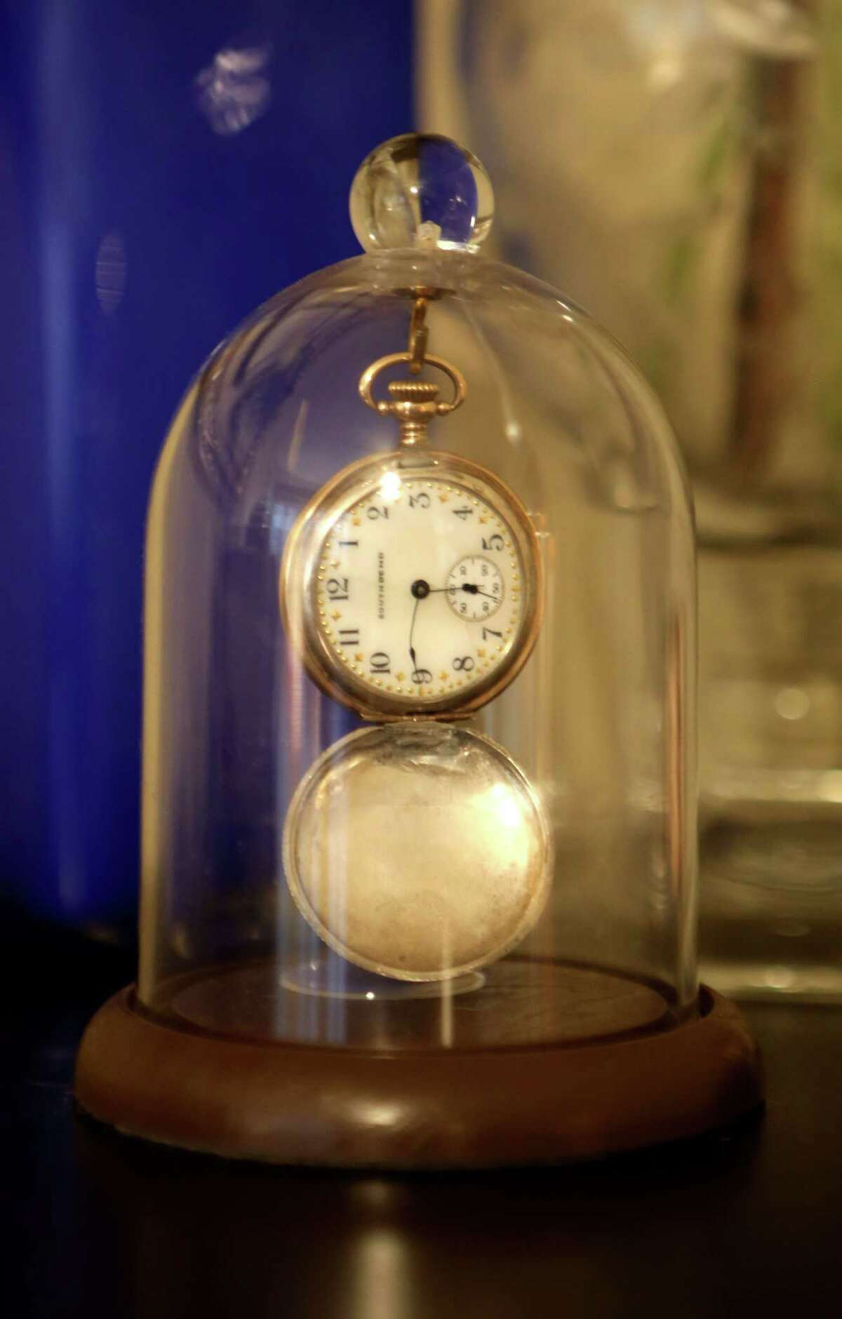 A pocket watch is preserved in a dome in the home of Paige Blend and Chris Berry .