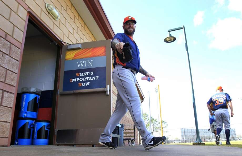Peter Moylan (58) smiles as he walks out of the clubhouse to begin the first full-squad workout on Thursday. Photo: Karen Warren, Houston Chronicle