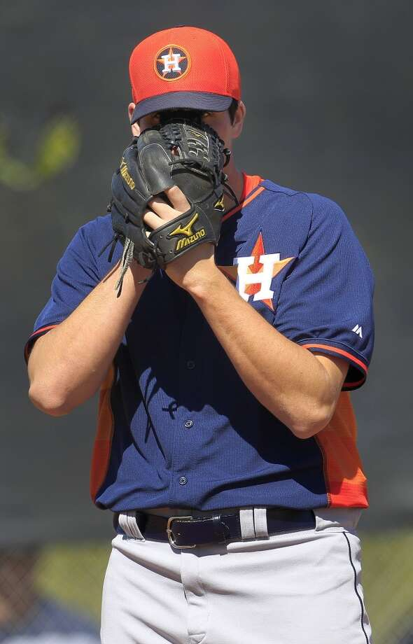 Mark Appel pitches off the mound during the first full-squad workout. Photo: Karen Warren, Houston Chronicle