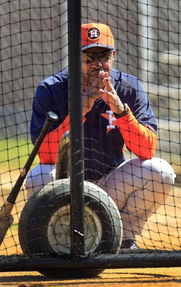 Bo Porter watches batters during the first full-squad workout. Photo: Karen Warren, Houston Chronicle