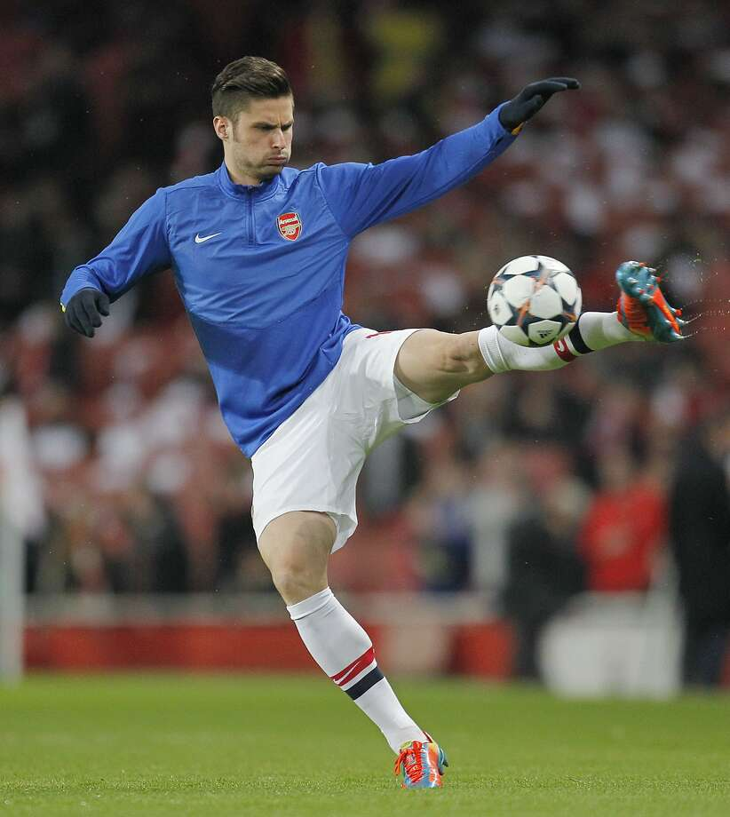 Arsenal striker Olivier Giroud was shown out of uniform in a hotel room by a British tabloid. Photo: Ian Kington, AFP/Getty Images