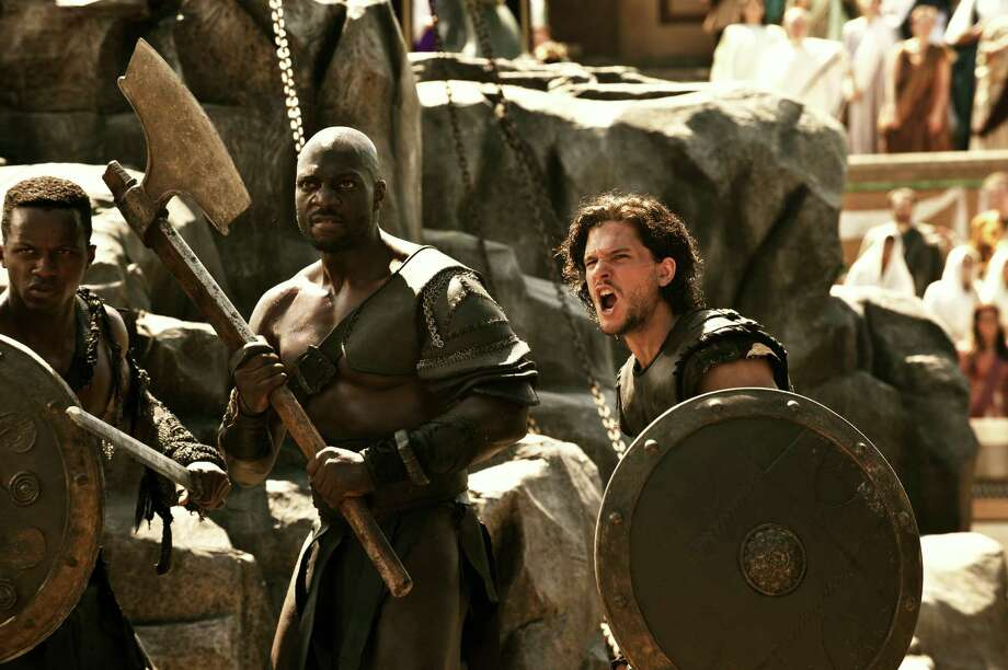 """Milo (Kit Harington, right), Atticus (Adewele Akinnouye-Agbaje) and other gladiators prepare to do battle  in """"Pompeii."""" Photo: -- / ©2014 Constantin Film International GmbH and Impact Pictures (Pompeii) Inc. All rights reserved."""