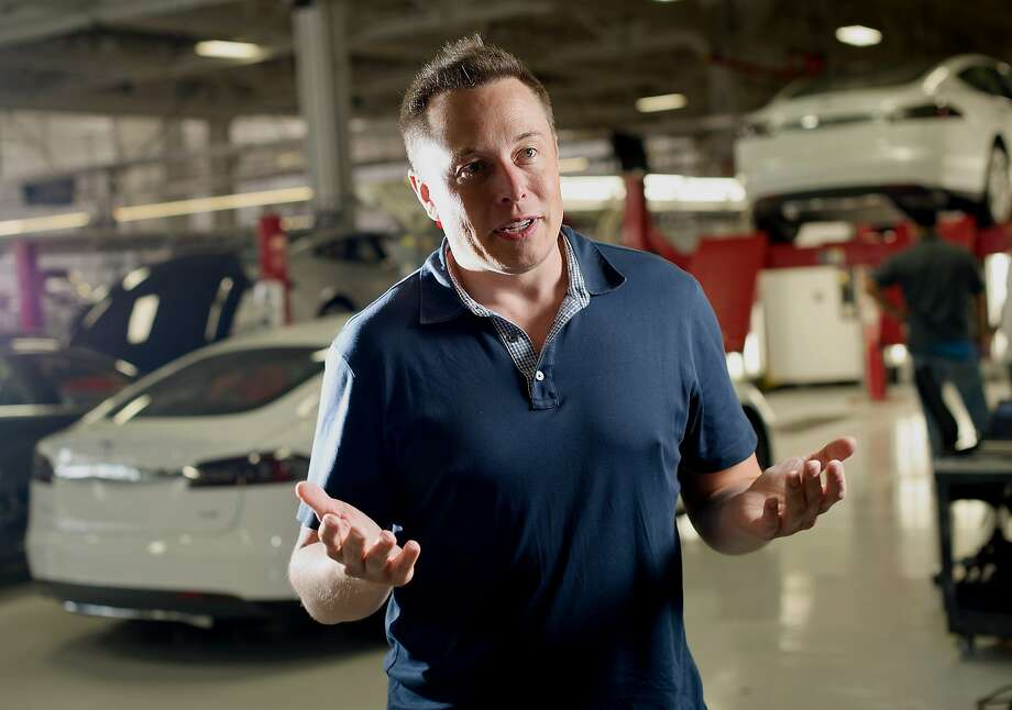 Elon Musk, co-founder and chief executive officer of Tesla Motors Inc., speaks during an interview at the company's assembly plant in Fremont, California, U.S., on Wednesday, July 10, 2013. Tesla, is building Model S electric sedans faster than its initial 400-a-week goal as demand and the company's production skills increase, Musk said. Photo: Noah Berger, Bloomberg
