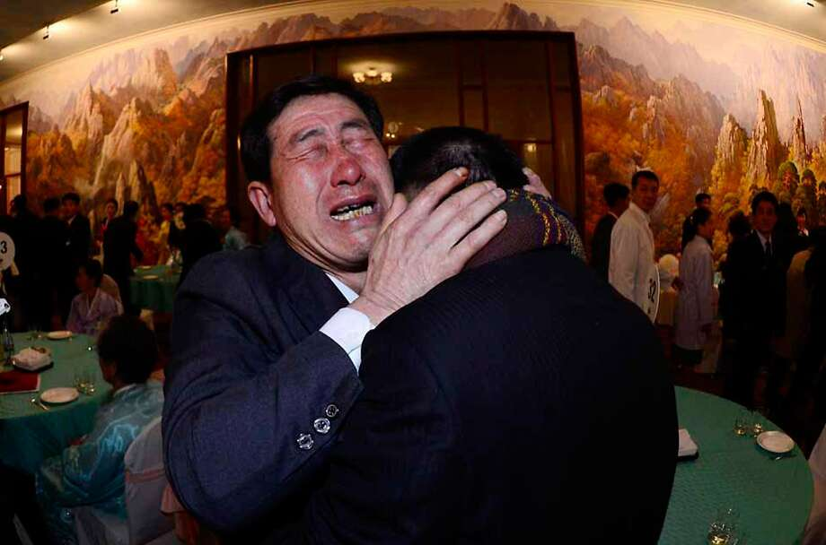 Park Yang-Gon (left) of South Korea greets his North Korean brother, Park Yang-Soo, during a family reunion at a resort in North Korea. About 80 South Koreans traveled to the reunion. Photo: Pool, Getty Images