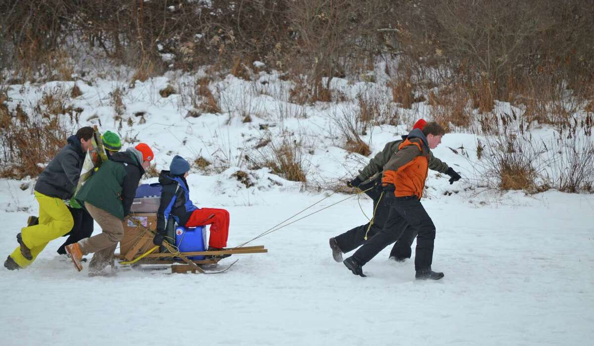 Boy Scouts from Greenwich's Troop 10 race their dog sled through the 300-yard Iditarod station at the Scouts' annual Klondike Derby, which was held recently.