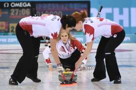 Feb 20, 2014; Sochi, RUSSIA; Jill Officer (CAN), Jennifer Jones (CAN), and Dawn McEwen (CAN) in the women's curling gold medal match during the Sochi 2014 Olympic Winter Games at Ice Cube Curling Center. Mandatory Credit: Kyle Terada-USA TODAY Sports