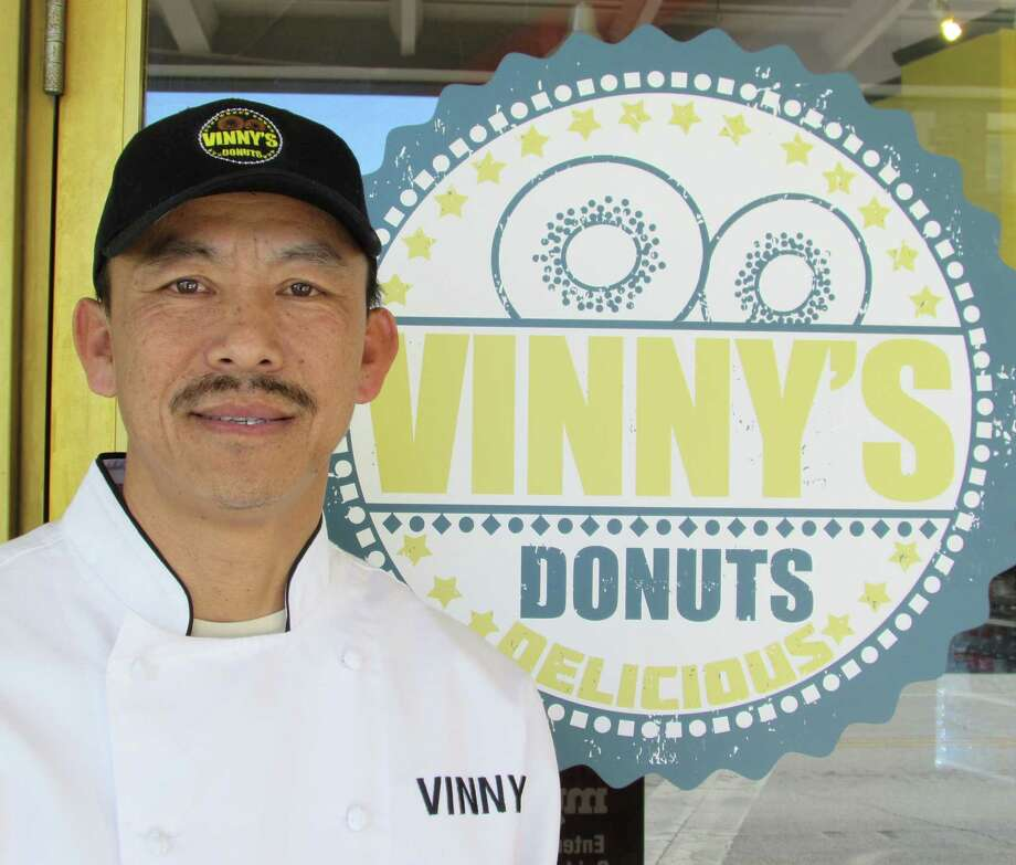 Vinny Pharakhone is the owner of Vinny's Donuts, which opened on Broadway in January 2014. Photo: Burt Henry, San Antonio Express-News