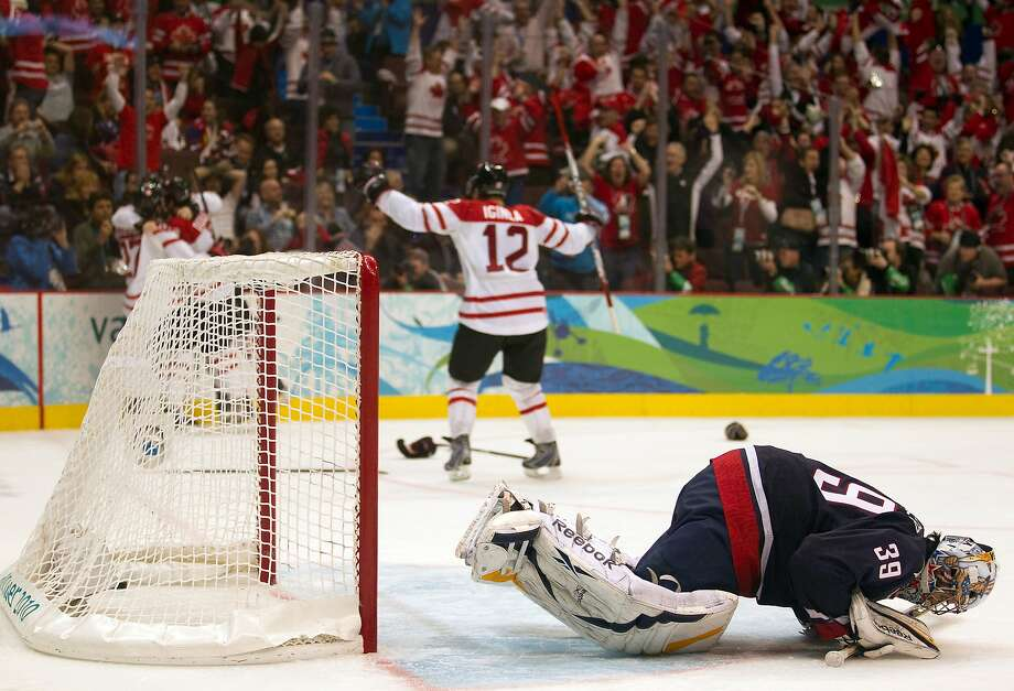 Jarome Iginla (12) celebrates Sidney Crosby's goal past Ryan Miller to give Canada the gold medal over the U.S. in 2010. Photo: Smiley N. Pool, Chronicle Olympic Bureau