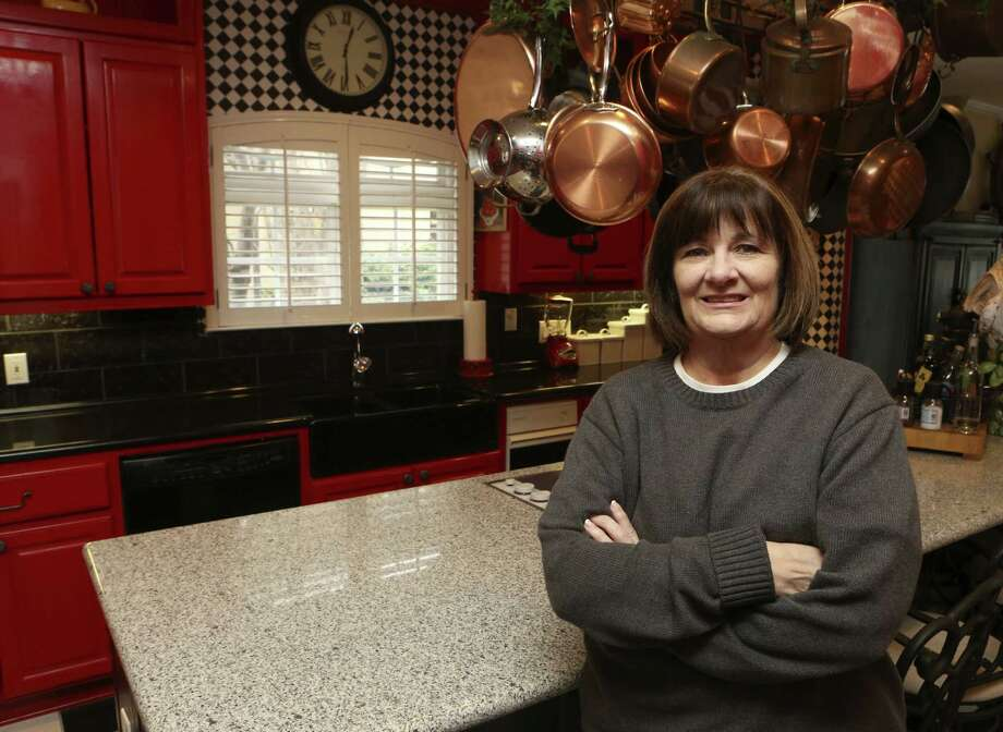 Kay Walker chose a red and black color scheme when she redid the kitchen of her Lake McQueeney home. Photo: Photos By Helen L. Montoya / San Antonio Express-News / ©2013 San Antonio Express-News