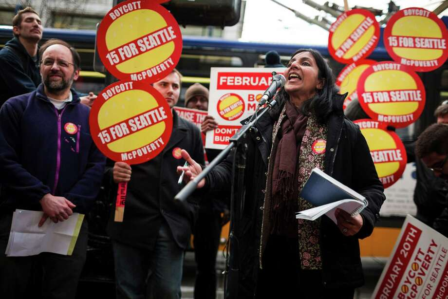 Seattle City Council member Kshama Sawant, right, rallies a crowd of Working Washington supporters protesting for 15 dollar minimum wage in front of McDonald's on 3rd Avenue and Pine Street Thursday, Feb. 20, 2014, in downtown Seattle. Photo: JORDAN STEAD, SEATTLEPI.COM / SEATTLEPI.COM