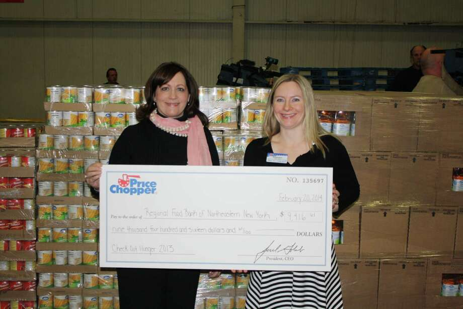 Regional Food Bank of Northeastern New York shared in $35,000 and 76,000 pounds of food raised by Price Chopper, shown by food bank?s Joanne Dwyer and Price Chopper?s Stephanie VanDerwerker.