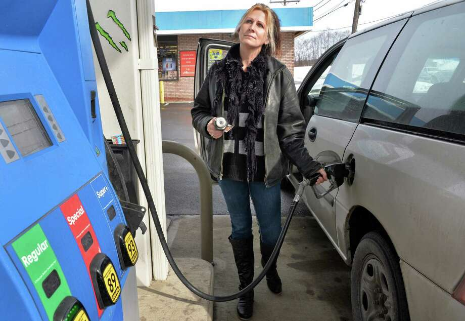 Cheryl Carolus of Scotia gases up her van at the Country Farm convenience store on Erie Blvd. Thursday, Feb. 20, 2014, in Schenectady, N.Y.  (John Carl D'Annibale / Times Union) Photo: John Carl D'Annibale / 00025840A