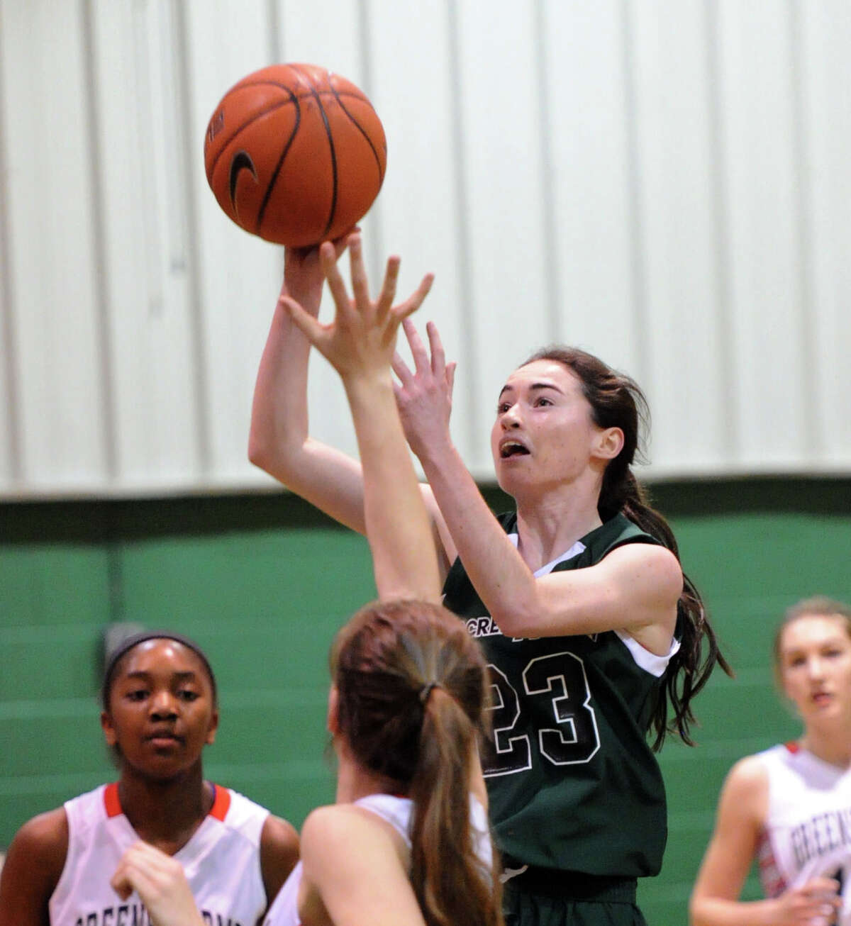 Colleen O'Neill (#23) of Convent of the Sacred Heart drives through a group of Greens Farms Academy defenders to score during the FAA girls high school basketball quarterfinals between Convent of the Sacred Heart and Greens Farms Academy at Convent in Greenwich, Thursday, Feb. 20, 2014.