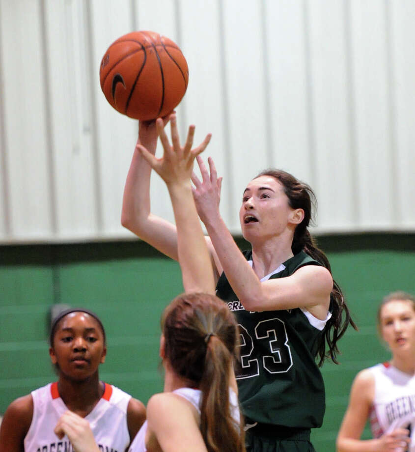 Colleen O'Neill (#23) of Convent of the Sacred Heart drives through a group of Greens Farms Academy defenders to score during the FAA girls high school basketball quarterfinals between Convent of the Sacred Heart and Greens Farms Academy at Convent in Greenwich, Thursday, Feb. 20, 2014. Photo: Bob Luckey / Greenwich Time