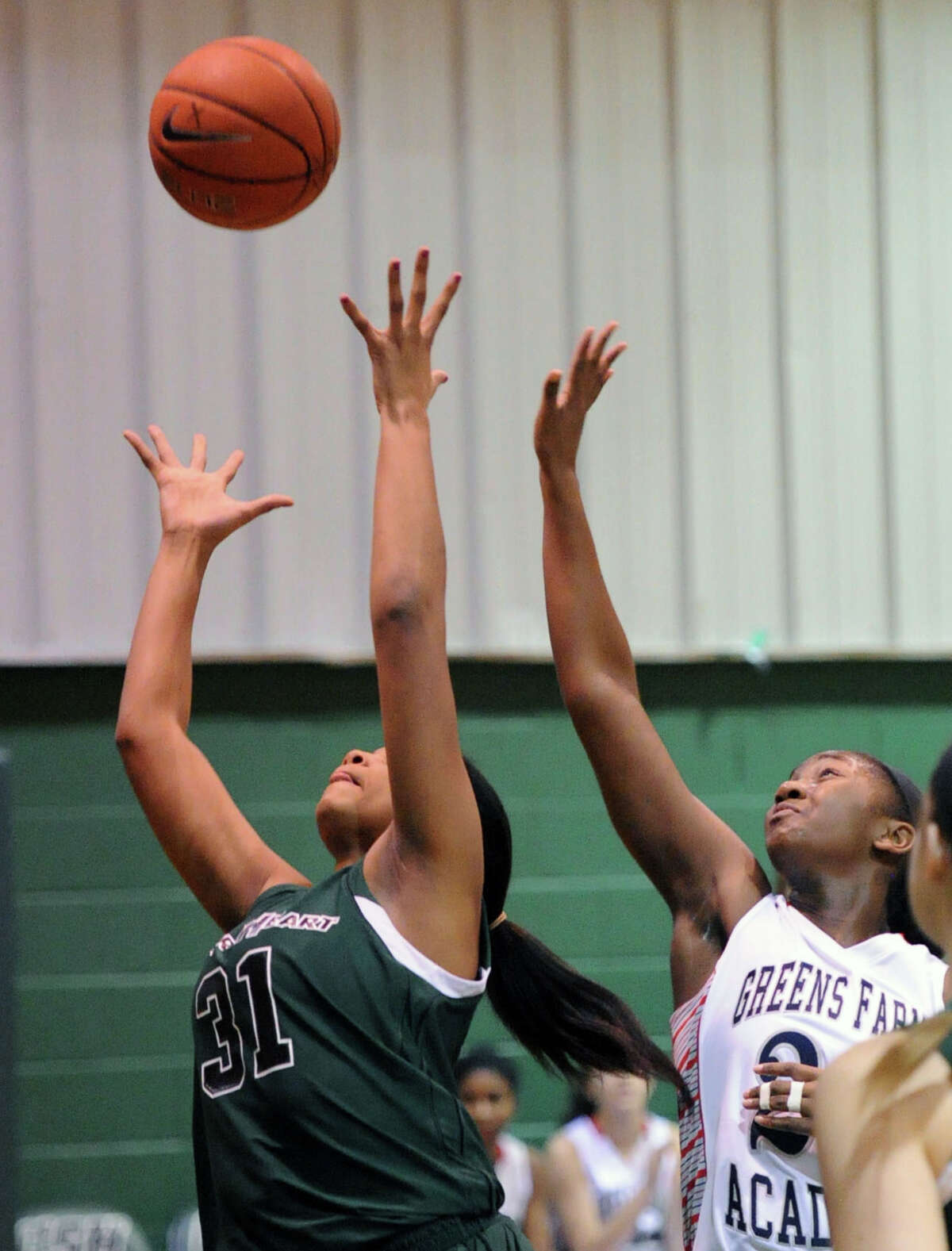 At left, Shelby Holland (#31) of Convent of the Sacred Heart grabs an offensive rebound as Lisa Johnson (# 22) of Greens Farms Academy at right, looks on during the FAA girls high school basketball quarterfinals between Convent of the Sacred Heart and Greens Farms Academy at Convent in Greenwich, Thursday, Feb. 20, 2014.