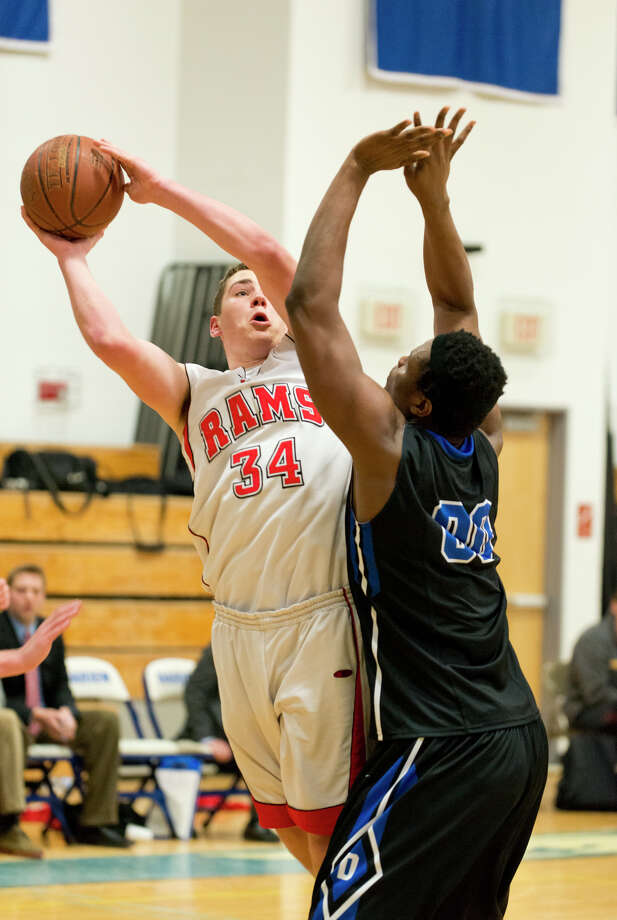 New Canaan's Zachary Allen (34) goes up for a shot as Darien's Chima Azuonwu (00) defends during the boys basketball game at Darien High School on Thursday, Feb. 20, 2014. Photo: Amy Mortensen / Connecticut Post Freelance