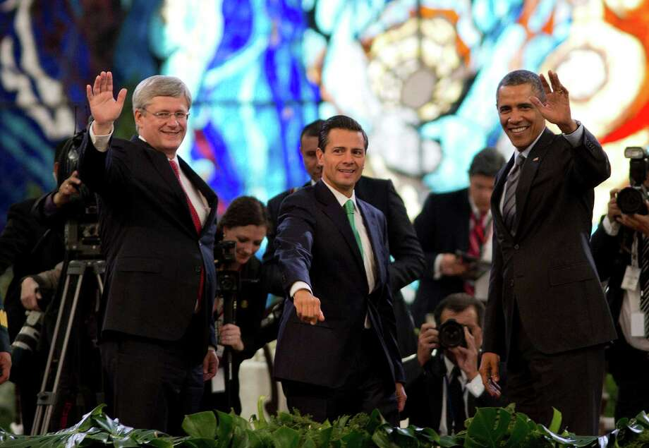 Canada Prime Minister Stephen Harper, left, Mexican President Enrique Peña Nieto and President Barack Obama met in February to highlight economic cooperation between the nations. Photo: Eduardo Verdugo, STF / AP