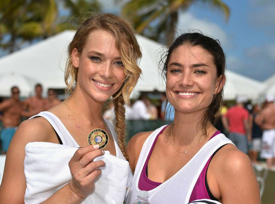 Kate Bock and Lauren Mellor attend Sports Illustrated Swimsuit Beach Volleyball Tournament on Ocean Drive at Miami Beach on February 20, 2014 in Miami, Florida. Photo: Frazer Harrison, (Credit Too Long, See Caption)