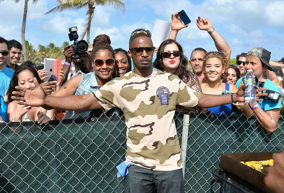 Jamie Foxx attends Sports Illustrated Swimsuit Beach Volleyball Tournament on Ocean Drive at Miami Beach on February 20, 2014 in Miami, Florida. Photo: Frazer Harrison, (Credit Too Long, See Caption)