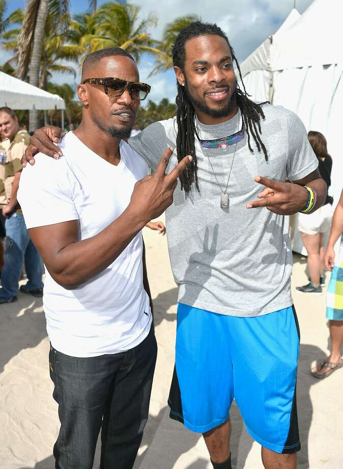 Jamie Foxx and Richard Sherman attends Sports Illustrated Swimsuit Beach Volleyball Tournament on Ocean Drive at Miami Beach on February 20, 2014 in Miami, Florida. Photo: Frazer Harrison, (Credit Too Long, See Caption)