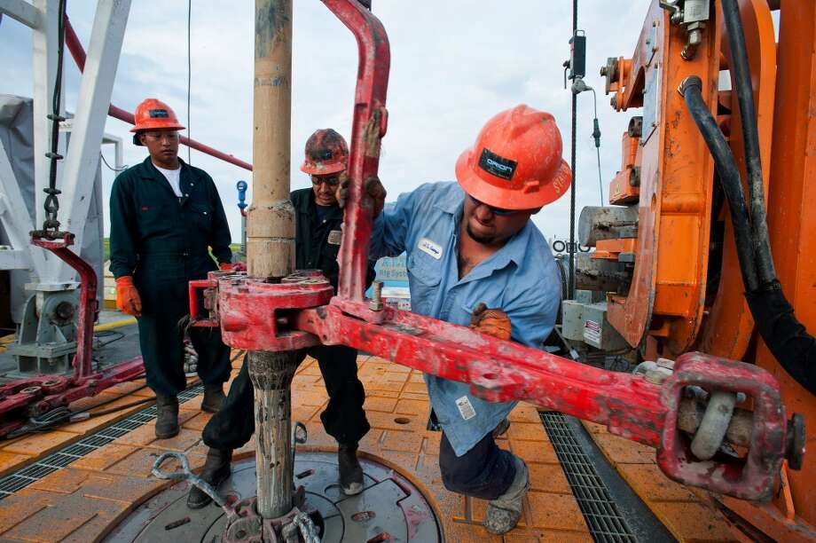 1. Eagle Ford Shale  Total water use: 19.2 billion gallons Average water per well: 4.5 million gallons Number of wells: 4,311  [Photo: Floor hands David Vannapha (left), Mario Ramos (center), and Jose Garza make a pipe connection on the drill string on the Orion Perseus drilling rig near Encinal in Webb County, Texas.] Photo: Eddie Seal