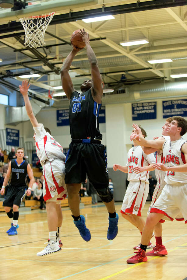 Darien's Chima Azuonwu (00) goes up for a shot against New Canaan during the boys basketball game at Darien High School on Thursday, Feb. 20, 2014. Photo: Amy Mortensen / Connecticut Post Freelance