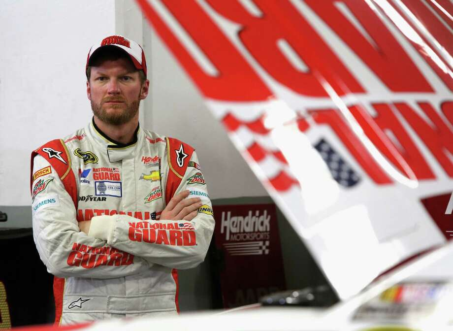 DAYTONA BEACH, FL - FEBRUARY 19:  Dale Earnhardt Jr., driver of the #88 National Guard Chevrolet, stands in the garage area during practice for the NASCAR Sprint Cup Series Daytona 500 at Daytona International Speedway on February 19, 2014 in Daytona Beach, Florida.  (Photo by Jerry Markland/Getty Images) ORG XMIT: 469265449 Photo: Jerry Markland / 2014 Getty Images