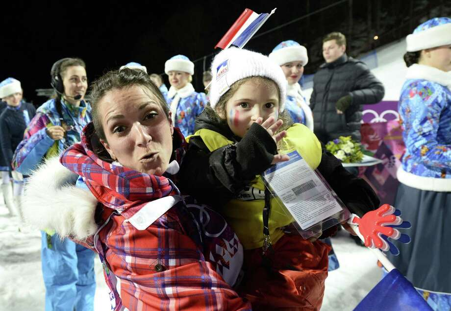 Silver Medallist, France's Marie Martinod and daughter Melirose celebrate in the Women's Freestyle Skiing Halfpipe finals at the Rosa Khutor Extreme Park during the Sochi Winter Olympics on February 20, 2014. AFP PHOTO / FRANCK FIFEFRANCK FIFE/AFP/Getty Images ORG XMIT: 461600043 Photo: FRANCK FIFE / AFP