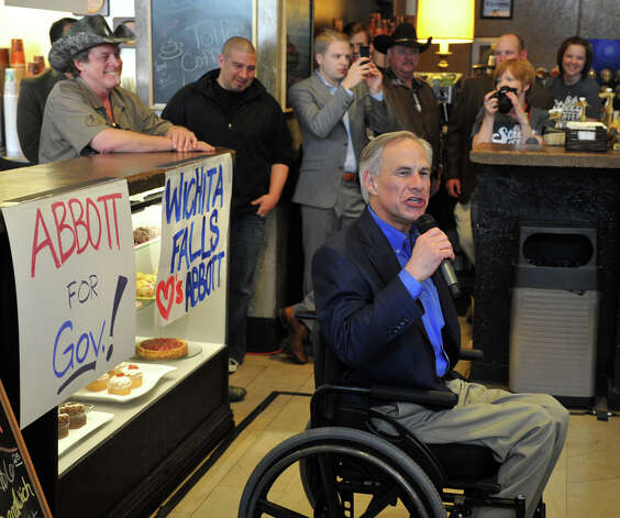 Texas gubernatorial candidate Greg Abbott, center, speaks to a crowd of supporters, Tuesday, Feb. 18, 2014, in Wichita Falls, Texas. Controversial rocker Ted Nugent, left, is campaigning for Abbott. (AP Photo/Wichita Falls Times Record News, Torin Halsey) Photo: Torin Halsey, Associated Press / Wichita Falls Times Record News