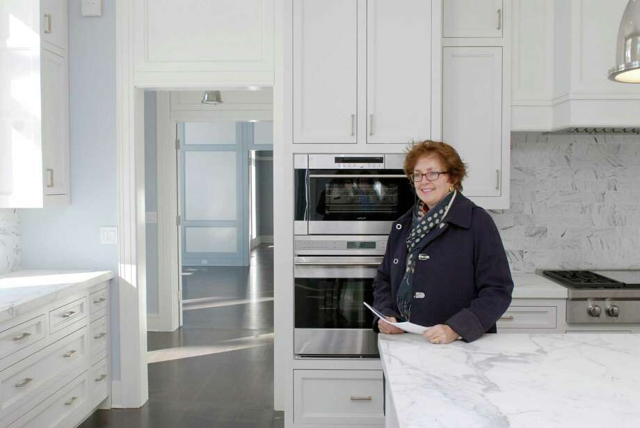 Realtor Barbara Wells gives a tour of 2 Wooddale Road in Greenwich, Conn. on Monday February 17, 2014. The home is listed for about $12 million. Photo: Dru Nadler / Stamford Advocate Freelance