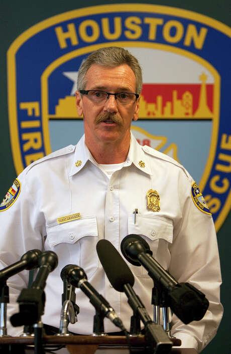 Houston Fire Department Chief Terry Garrison speaks during a news conference at the fire department's headquarters Friday, Jan. 27, 2012, in Houston. He spoke about the arrest of Captain Saul Fiszer who was arrested for charges in a sex case. The captain was hired in April 1994. (Cody Duty / Houston Chronicle) Photo: Cody Duty, Staff / © 2011 Houston Chronicle