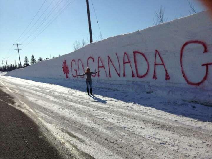 Tanya L. Volchek-Vilcu of Niskayuna stands next to snowbanks in Kitchener, Ontario, where her husban