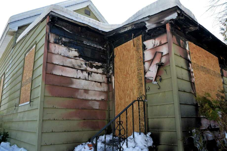 Fire damage to the rear of a vacant home at 1328 Floral Avenue Thursday, Feb. 20, 2014, in Rotterdam, N.Y. Rotterdam officials say that this is the third suspicious fire within the past month. (John Carl D'Annibale / Times Union) Photo: John Carl D'Annibale / 00025836A