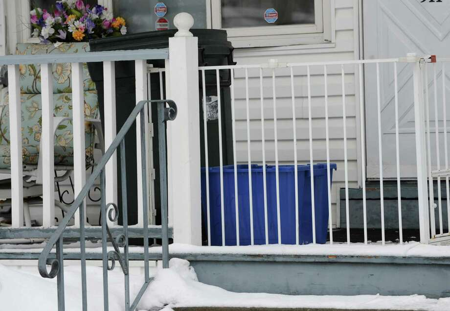 A recycling container is seen on a porch in the Mont Pleasant neighborhood on Wednesday, Feb. 19, 2014 in Schenectady, N.Y.  (Lori Van Buren / Times Union) Photo: Lori Van Buren / 00025821A