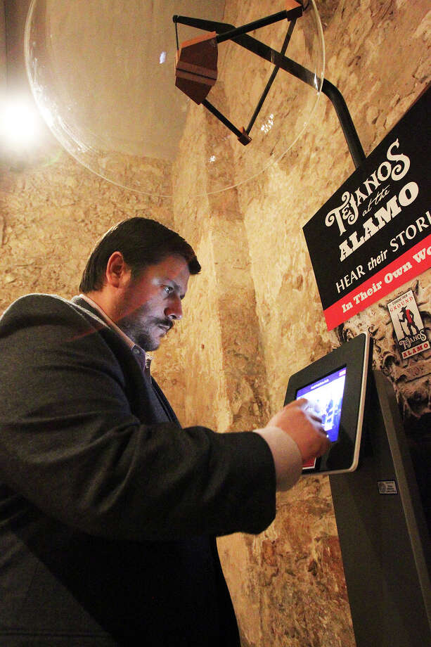 "Dr. Jose Barragan demonstrates an audio information station where visitors will hear the story of Tejanos at the Alamo in a preview presentation of ""Standing Their Ground: Tejanos at the Alamo"" on February 20, 2014. Photo: TOM REEL"