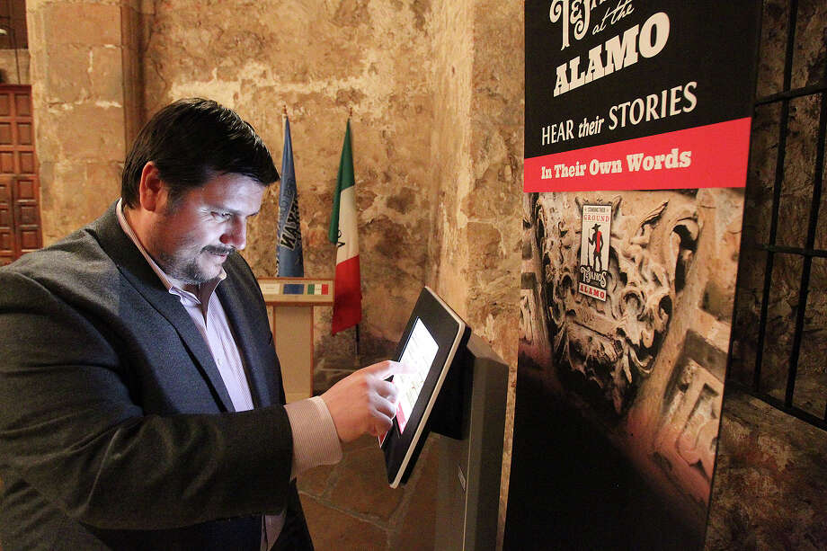 "Dr. Jose Barragan demonstrates an audio information station where visitors will hear the story of Tejanos at the Alamo in a preview presentation of ""Standing Their Ground: Tejanos at the Alamo"" on February 20, 2014. Photo: TOM REEL, San Antonio Express-News / San Antonio Express-News"