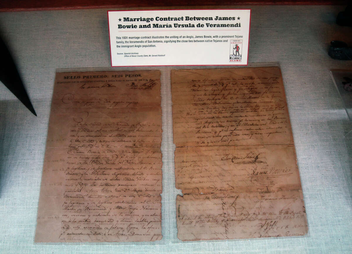 A document signed by James Bowie is on display as visitors hear the story of Tejanos at the Alamo in a preview presentation of