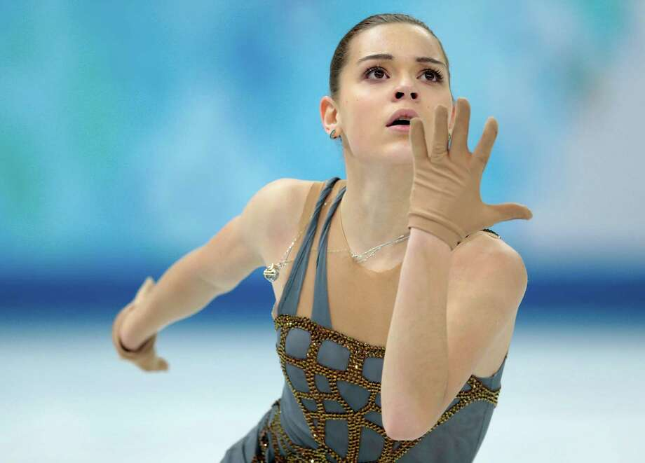 Adelina Sotnikova of Russia competes in the women's free skate figure skating finals at the Iceberg Skating Palace during the 2014 Winter Olympics, Thursday, Feb. 20, 2014, in Sochi, Russia. (AP Photo/Ivan Sekretarev) ORG XMIT: OLYFS489 Photo: Ivan Sekretarev / AP