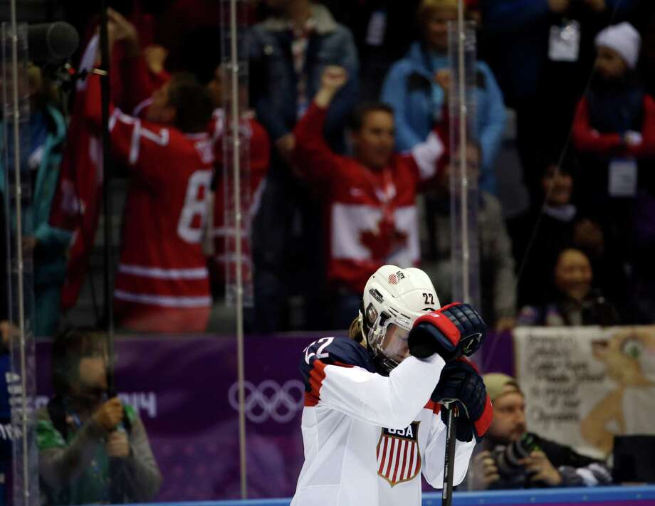 Kacey Bellamy of the United States (22) reacts after Canada won 3-2 in overtime of the gold medal women's ice hockey game at the 2014 Winter Olympics, Wednesday, Feb. 19, 2014, in Sochi, Russia. (AP Photo/David Goldman) ORG XMIT: OLYWH385 Photo: David Goldman / AP