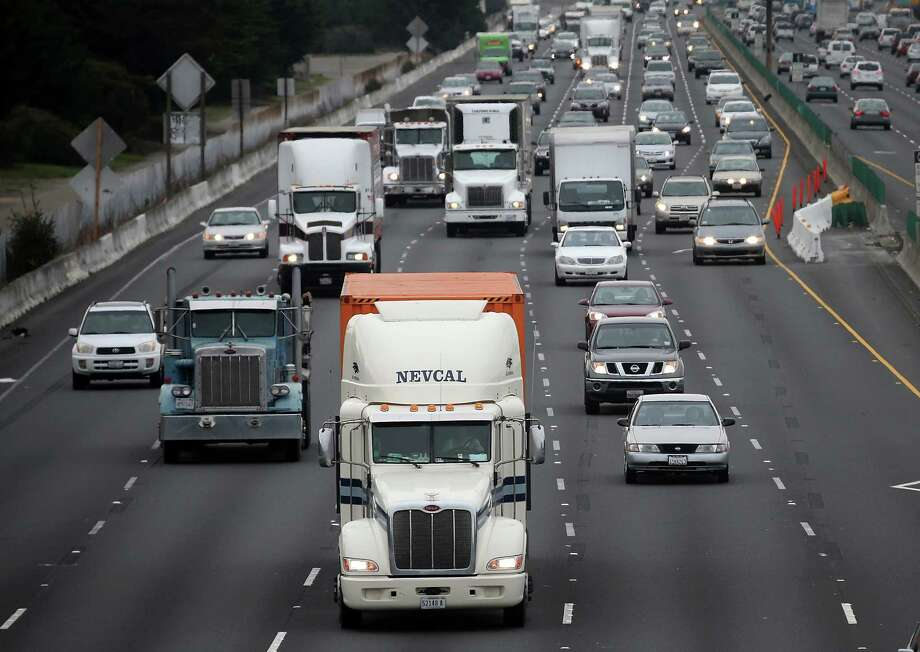BERKELEY, CA - FEBRUARY 18:  Trucks drive along Interstate 80 on February 18, 2014 in Berkeley, California. U.S. President Barack Obama announced that his administration is beginning to develop a new phase of tighter fuel efficiency standards for medium and heavy-duty vehicles and has ordered the Environmental Protection Agency and Transportation Department's National Highway Traffic Safety Administration to create and impose new fuel-efficiency and greenhouse gas standards by March 31, 2016. (Photo by Justin Sullivan/Getty Images) ORG XMIT: 470620163 Photo: Justin Sullivan / 2014 Getty Images