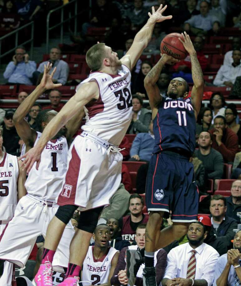 Connecticut's Ryan Boatright (11) shoots as Temple's Dalton Pepper (32) defends in the first half of an NCAA college basketball game, Thursday, Feb. 20, 2014 in Philadelphia. (AP Photo/H. Rumph Jr.) Photo: H. RUMPH JR, Associated Press / Associated Press