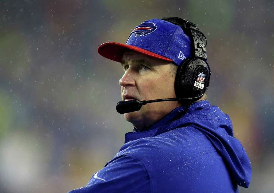Bills coach Doug Marrone, above, got a year NFL head start on Bill O'Brien. Photo: Steven Senne, STF / AP